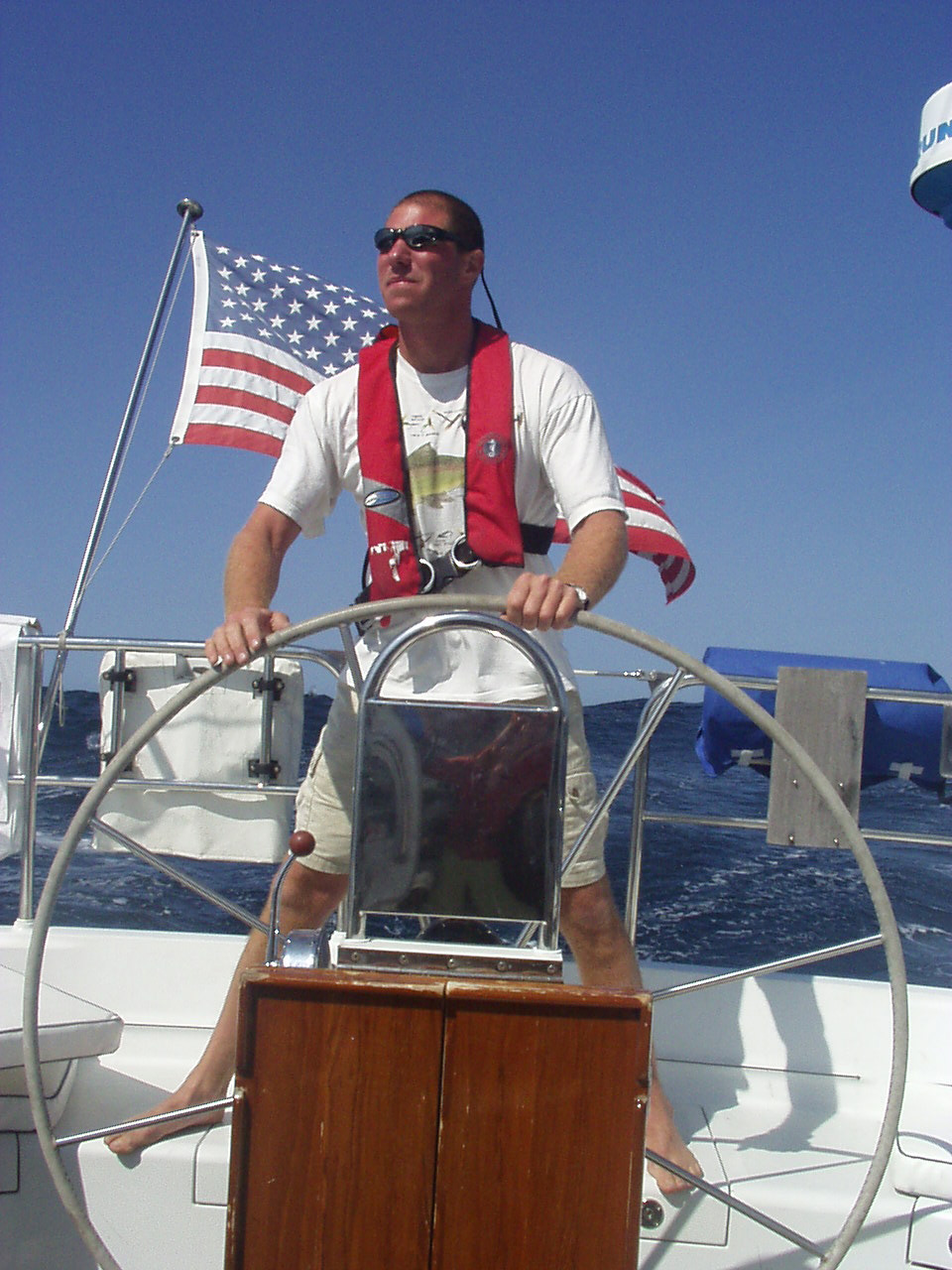 Photo of Dr Al Gross at the helm of his boat